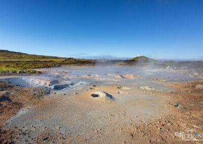 Gunnuhaver geothermal area with Reykjanesviti Lighthouse in the