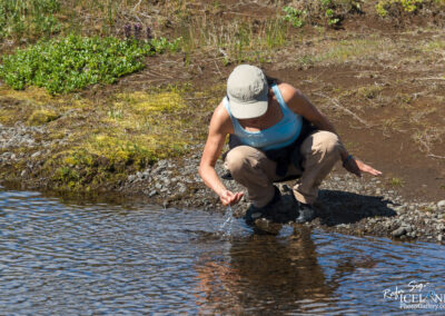 Girl drinking water from a river │ Iceland Photography