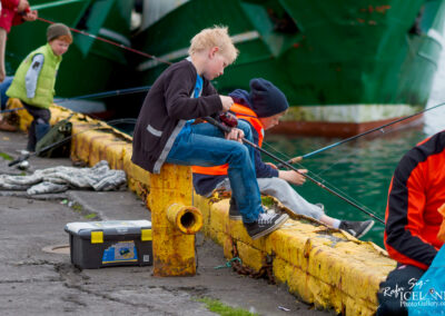People fishing at the harbour of Grindavík │ Iceland City Photography